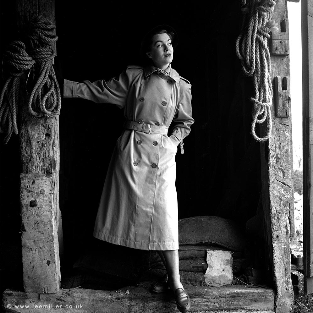 Fashion model wearing trench coat in Farleys Gallery 1950