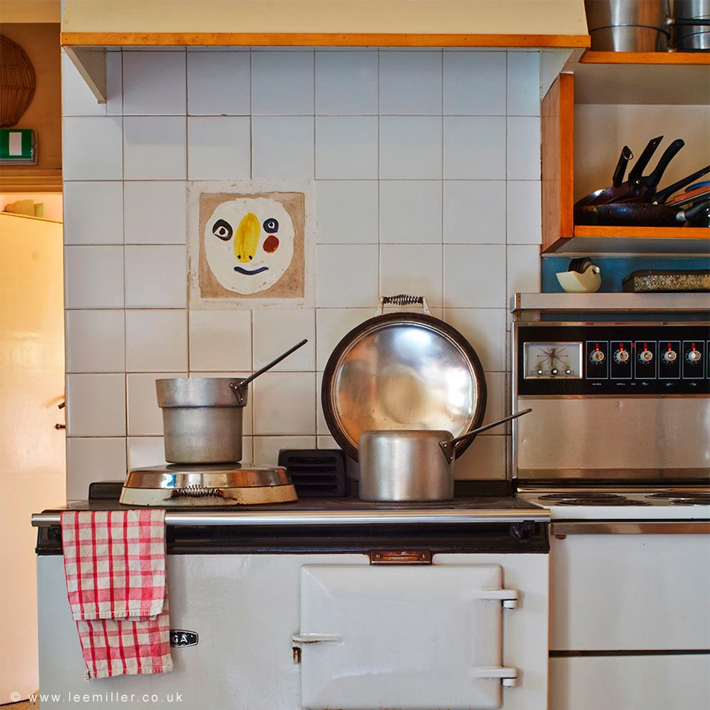 Aga with Picasso tile above in the kitchen at Farleys