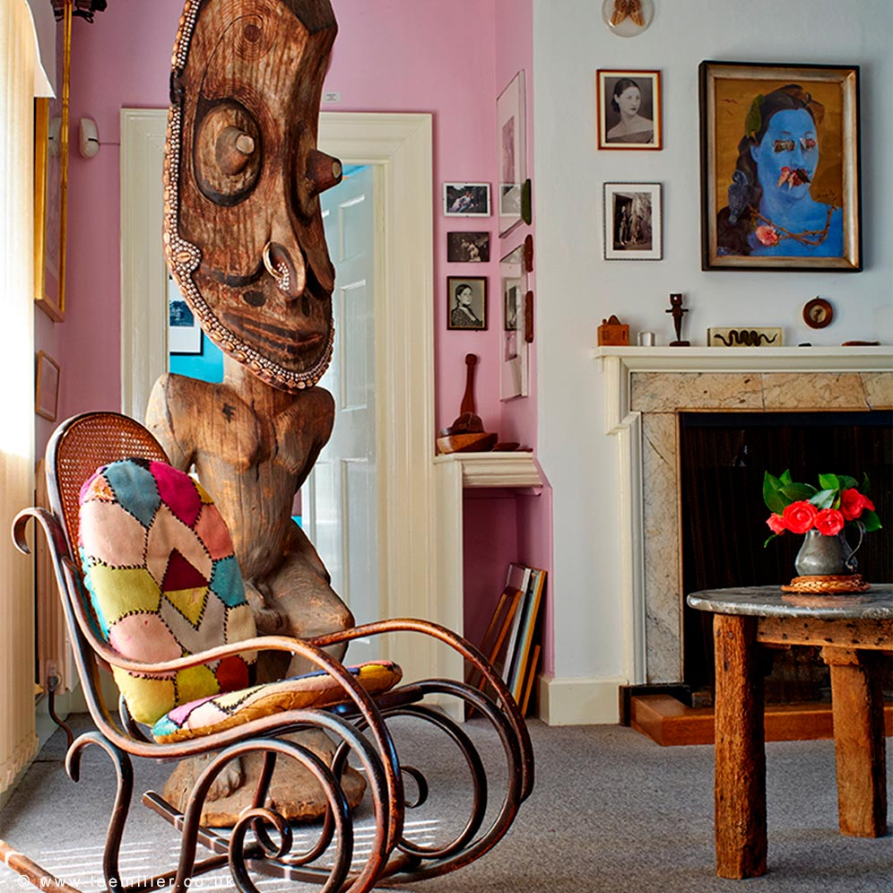 Rocking chair and artworks displayed in the sitting room of Farleys