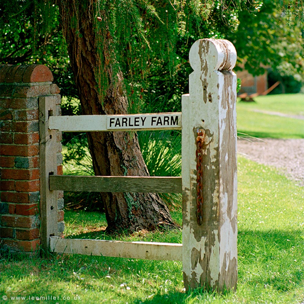 Gate post with sign for Farley Farm