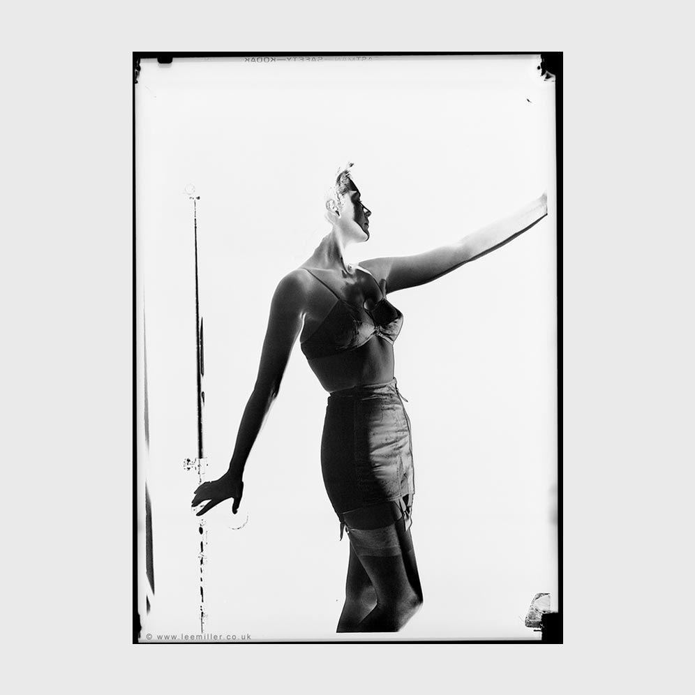 Solarised photograph of woman wearing corset in Vogue studio 1942