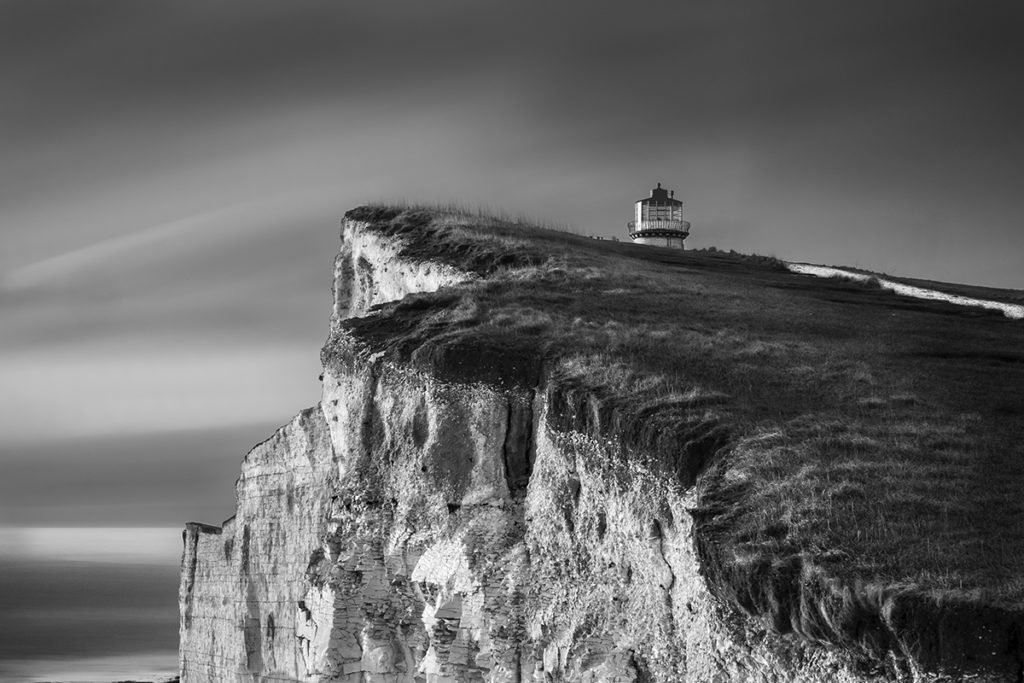 Photograph of cliff edge and lighthouse by Lin Gregory