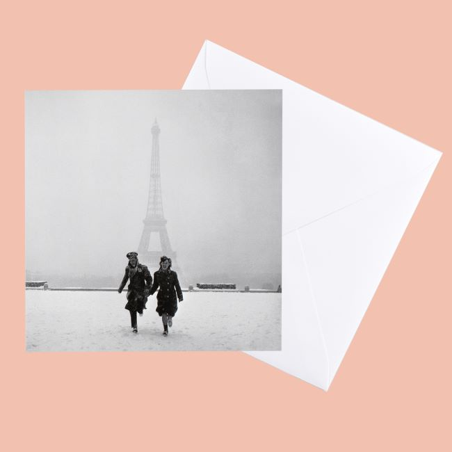 Image of greeting card of Lee Miller photograph of couple running in front of the Eiffel Tower