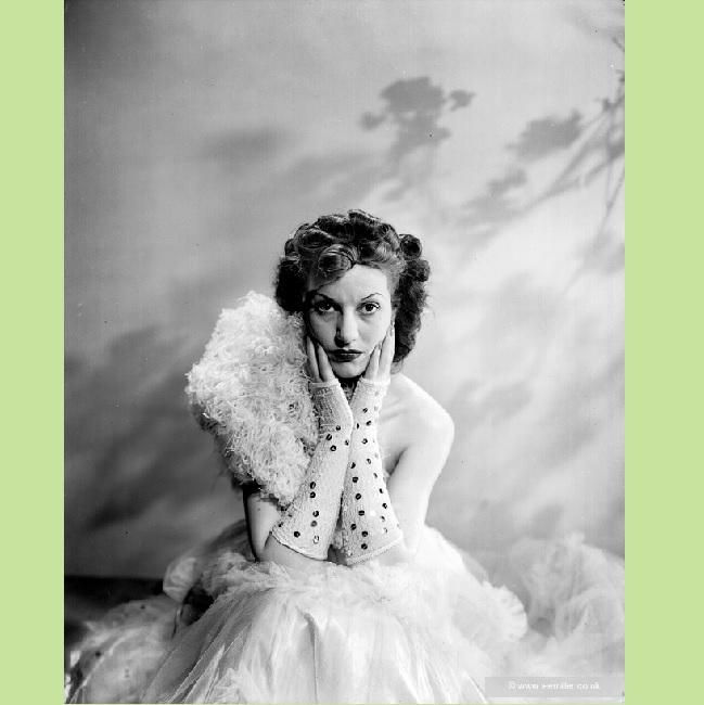 Actress Judy Campbell modelling an evening dress