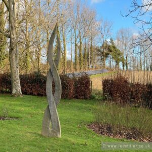 wooden sculpture in Farleys garden by Keith Pettit